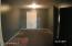 Large Utility Room off kitchen, exit to garage or back yard.