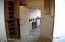 Laundry room with cabinets, exit to garage.