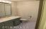 Full Hallway Bath with Skylight for natural light.