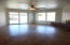 Dining room with hardwood floors, pass-thru fireplace and sliding glass door for easy backyard access.