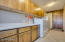 Large laundry room with tons of storage, room for a refrigerator, ample counter top space and a utility sink!