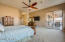 The master suite is DOWNSTAIRS, tons of natural light, sliding glass doors directly to patio and pool and very spacious!