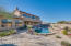 This backyard is ready to entertain with a pebbletec pool with built-in cleaning system, elevated travertine patios, huge covered patio and endless sunset views!