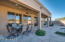 The large covered patio offers ample space to enjoy the shade or dine outside!