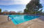 One of the 3 Jr. Olympic sized pools (1 heated) Mature tree allow you to choose to stay in the shade or bask in the sun