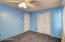 Other view of blue bedroom showing front door and closet door (new carpet installed AFTER picture taken)