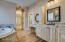 Master bath. Custom cabinetry. Built in laundry hampers.
