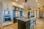 Custom kitchen cabinets with lots of drawers, buffet cabinets that open to dining as well as kitchen.