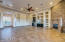 Large family room/great room with wet bar, electric fireplace, surround sound, and beautiful views to the North and South.