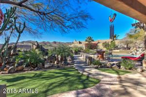 Faux grass, multiple patios, views!