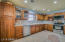 Granite backsplash goes up the wall to the bottom of the cabinets