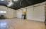 Garage/studio has 14' ceilings and extra wide overhead doors