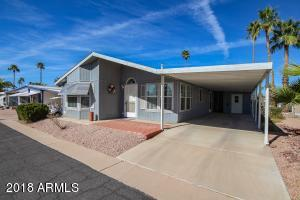 Spacious manufactured home with plenty of parking for 2 vehicles, plus a little extra for a golf cart.