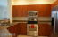 The kitchen has SS appliances, including a new dishwasher, great storage and a desk nook.
