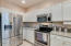 Painted cabinets, stainless steel fridge and appliances