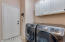 Laundry Room with storage and plumbed for a sink