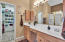 Master bath with double sink vanity, separate shower and tub