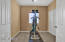 Bedroom 4 with double doors and closet, can be used as workout or office