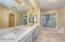 Large Bathroom with double basins, soaking tub and separate shower.