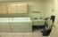 big laundry room with storage and wash sink