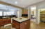 Kitchen island countertop is granite.