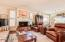Family room/Den with Wood burning fireplace and loads of windows.
