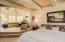Master bedroom with elevated seating room with fireplace and view of mountains.