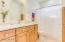 Large Hall Bath With Beautiful Light Wood Cabinets