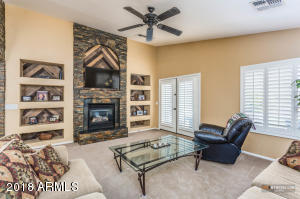 The family room is upgraded with stone accents surrounding the gas fireplace and TV. Upgraded shelf accents.