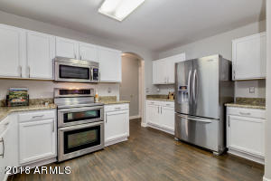 Ample cabinets. kitchen is equipped with stainless steel appliances: Wow !! A double oven too!! Granite countertops and walk -in pantry!