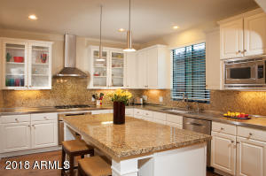 Beautiful kitchen with stainless steal and granite counters and stainless appliances.