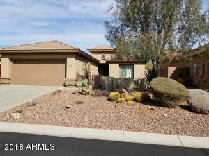 Front of property with desert landscaping