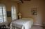 Casita with bedroom and full bathroom, plantation shutters, courtyard entry.