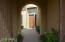 Gated courtyard entry to main home and casita