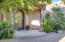 Grand front entrance through a private gated courtyard with 10' custom wrought iron door and rotunda.