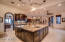 Gourmet kitchen with Viking appliances, breakfast nook and an oversized center island.