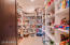 Gigantic walk in pantry with a ton of storage space.