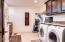 Spacious laundry room with extra storage.