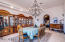 Formal dining room with enough space to seat 10+ and a centerpiece chandelier.