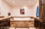 Master bathroom with jacuzzi tub and separate shower, wet bar, en suite laundry and dressing area.