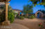 Grand front entrance through a private gated courtyard with 9' custom wrought iron door and rotunda.