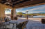 Back patio with an infinity edge pool and spa with fire elements surrounding and beautiful mountain views.