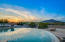 Infinity Edge Pool and Spa with fire elements surrounding and beautiful mountain views.