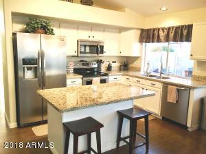 Remodeled kitchen with granite countertops, updated cabinets and stainless steel smudge proof appliances