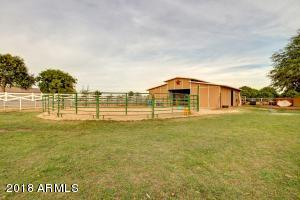 Expansive back yard with barn, round pen, just bring your own panels to complete.
