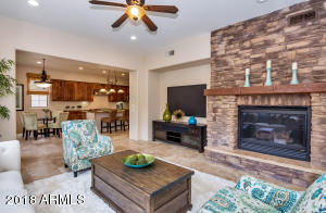 Large Family Room is perfect for entertaining. The entire downstairs with the exception of the bedroom has luxury Travertine Flooring