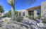 Lovely courtyard with benches, surrounding the breathtaking Saguaro, front and center with stacked stone planters surrounding it!