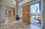 A travertine mosaic tile is the centerpiece of the foyer as you enter this great room plan that is rare and highly sought after!