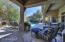 Three sliding doors leading to the private backyard with flagstone covered patio and flagstone surrounding entire patio!