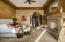 Generous master suite with private hallway leading to his and her closets and spa like oasis.